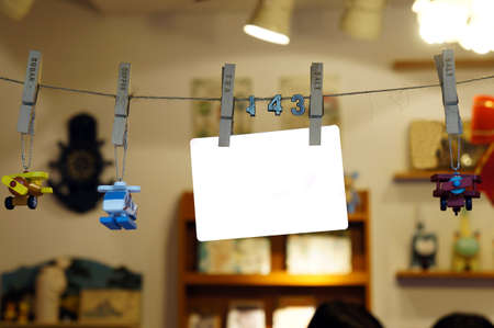 Blank hanging paper card and plastic toys Stock Photo