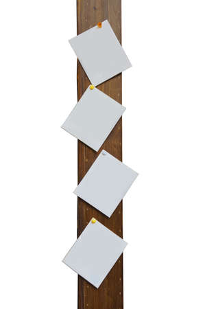 Blank paper cards nailed on wooden pole Stock Photo