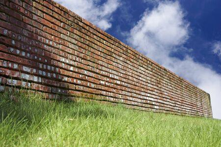 Brick wall over blue sky