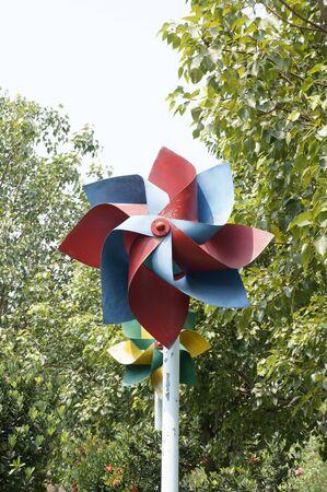 winnowing: Windmill among trees
