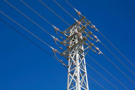 Power lines over blue sky
