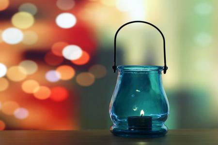 Glass lantern over light shadow background Stock Photo