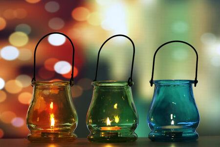 Glass lanterns over light shadow background Stock Photo