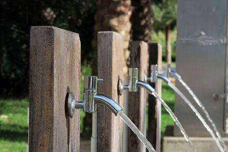 beachfront: Flushing taps outside beachfront hotel