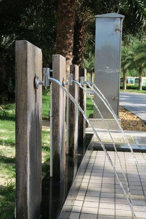 flushing: Flushing taps of beachfront hotel Stock Photo
