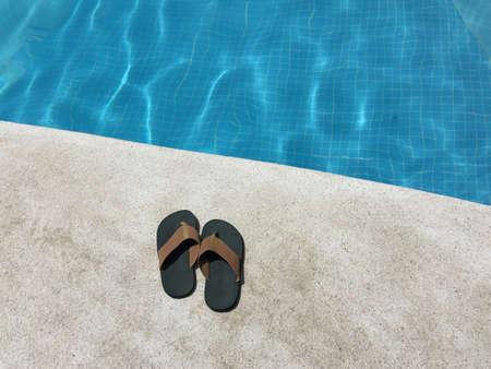 swim shoes: Slipper on edge of pool