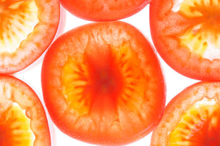 Tomato slices in water with bubbles