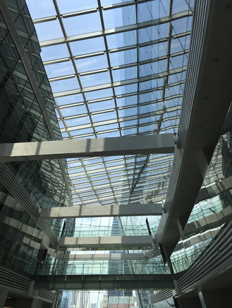 Building with glass roof for saving energy for lighting