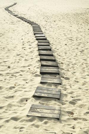 Houten pad naar de zee
