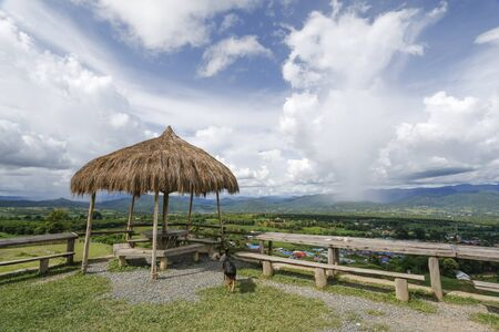 Viewing platform over blue sky and white clouds