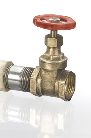 steel pipes and a valve on a white background
