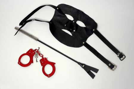isolated pairs of handcuffs and keys mask wives sex objects Stock Photo - 10541838