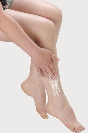 cau: woman legs with cream care