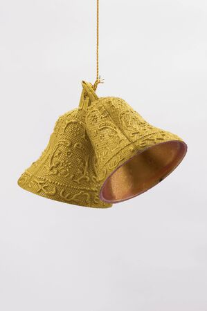 festival scales: golden christmas bells on white background