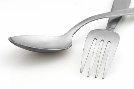 fork and spoon on white background Stock Photo - 10541876