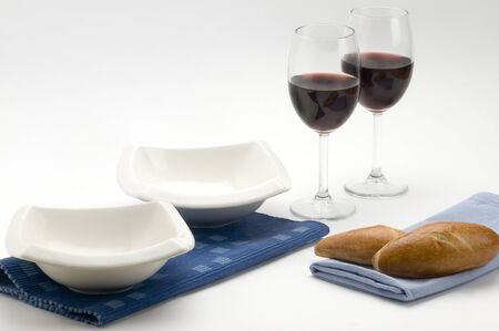 platon: plates, cups dishes with red wine and bread Stock Photo