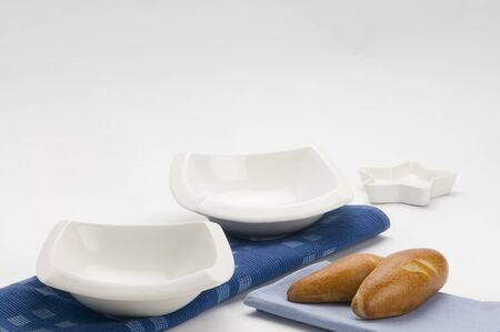 platon: table set with plate, white plates and napkins and bread Stock Photo