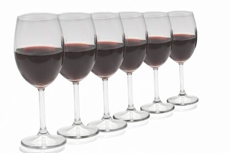 red wine glasses in a row on white background Stock Photo - 10616309