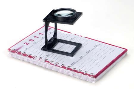 magnifying glass and notebook Stock Photo - 10616177