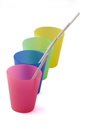 plastic cups on white background photo