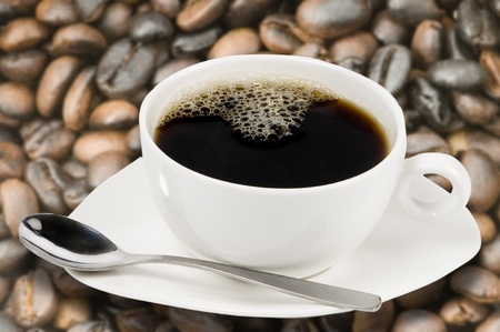 white coffee cup with coffee beans background photo