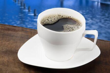 white coffee mug with a blue background Stock Photo - 10763872