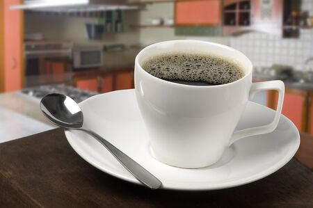white coffee cup with cooking background photo