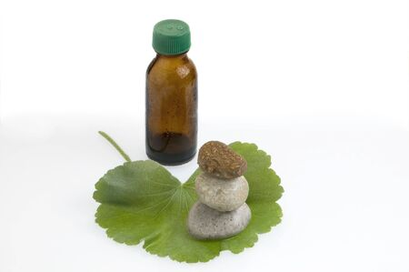 spa still life with oil, leaves and stones photo