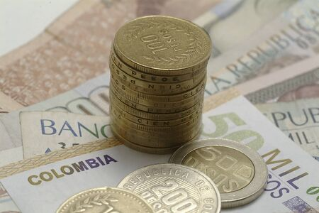 pesos: currency and Colombian Pesos