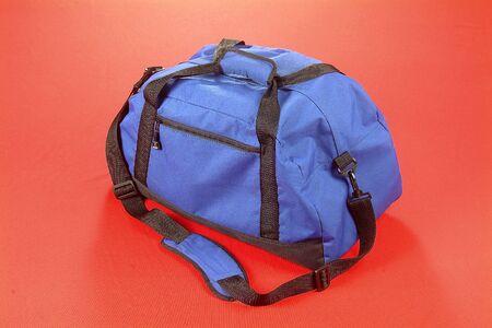 Blue Bag Red Background