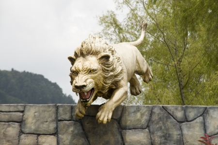 Statue of a lion jumping Stock Photo - 13686935