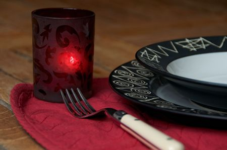 Detail of a table set for a romatic diner outdoors Stock Photo