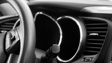 vent: Closeup of Steering Wheel and Dashboard with Shallow Depth of Field