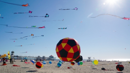 Colorful Kites at the Beach with the Huntington Beach Pier in the Background