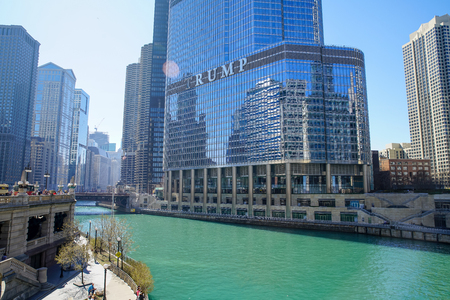 CHICAGO, IL - April 15, 2016: Chicago River in the daytime. Trump International Hotel and Tower, a skyscraper condo hotel located in downtown Chicago, Illinois