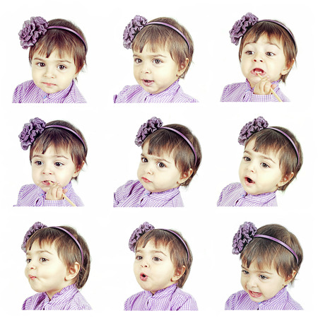 Caucasian little girl expresses emotions photo