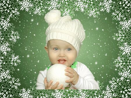Christmas green frame with a white little girl with snowball photo