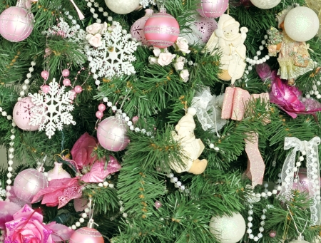 Christmas tree decorated with pink balloons and ribbons photo