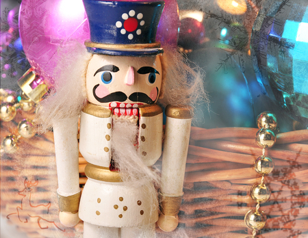 kids weaving: Christmas toy nutcracker with Christmas balls and snow