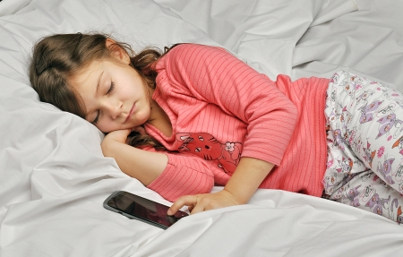 questioned: girl sleeps and waits for a call by phone Stock Photo