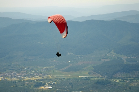 paraglider flying over the mountains in Spain
