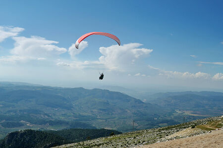paraglider flying over the mountains in Spain photo