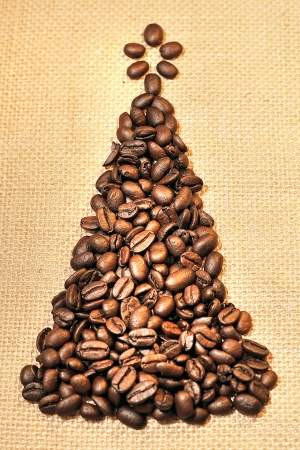 coffee beans in the form of a Christmas tree on textiles photo
