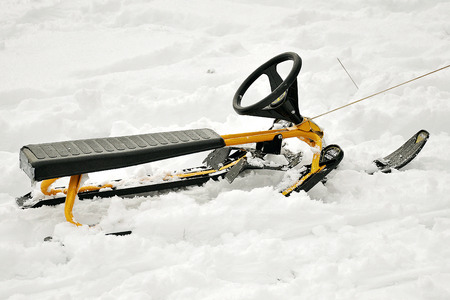 frost bound: snow scooter driven by a rope Stock Photo