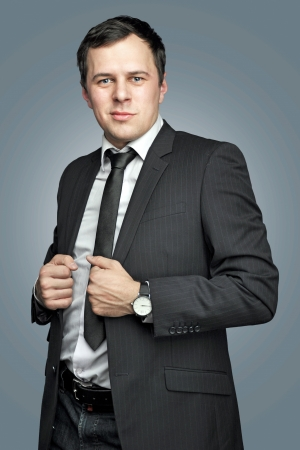 confident young businessman in an office suit photo