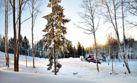 tractor aligns ski hill photo