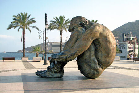 man sitting in the port of Cartagena, Spain, Murcia photo