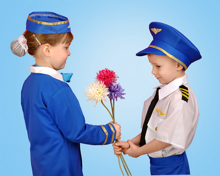 boy dressed as a pilot, gives a girl flowers photo