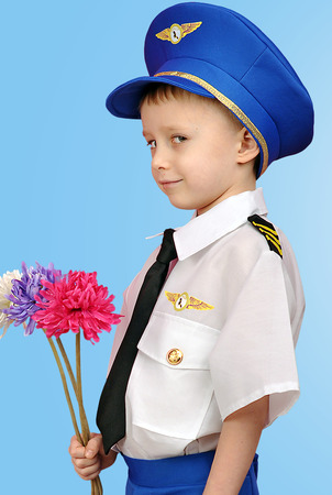 little boy in a suit Pilot with flowers photo