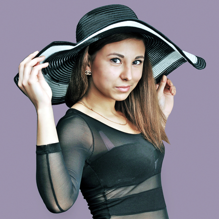 Caucasian woman holding a hat in body photo